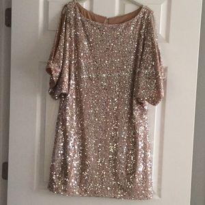 Rose Gold sequined shift dress with cold shoulder.